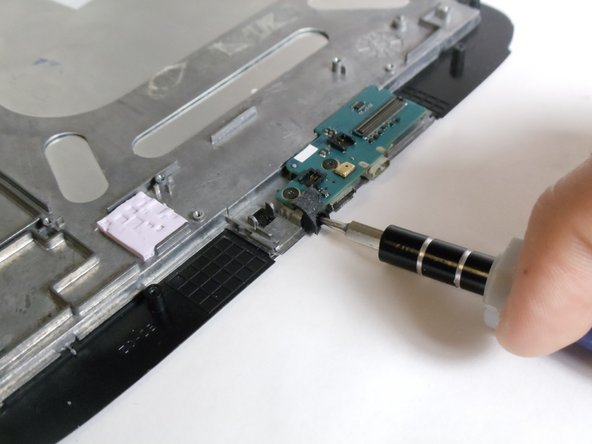 Remove the 2mm Torx T-4 screw on the front use a Torx T-4 screwdriver from the iFixit tool kit.