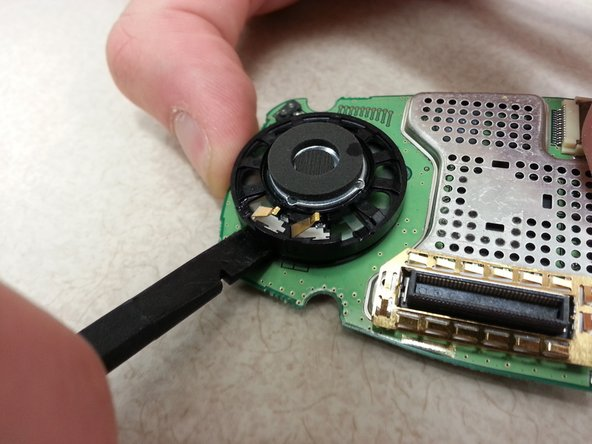 Using the spudger, pry the speaker off of the circuit board.