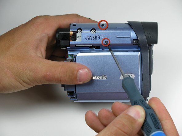 Remove the indicated 4.5mm screws from the LCD side of the camera.