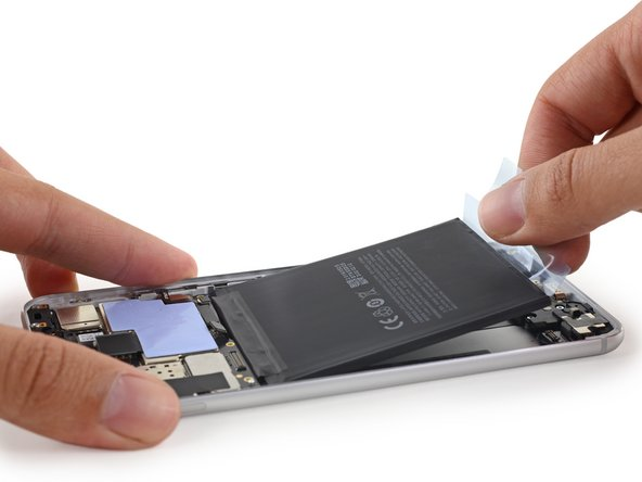With the display assembly out of the way, we carefully excavate the MX6's stubbornly-adhered battery. Luckily, the battery features an iPhone 4-esque battery pull tab that makes the job a bit easier.