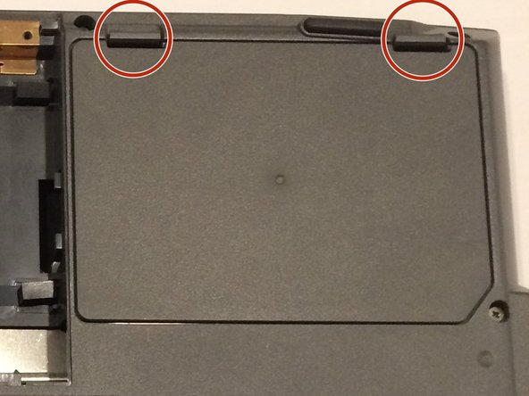 Image 2/2: Flip your laptop such that the bottom of the laptop is facing up.
