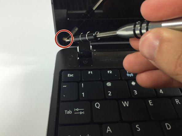 Remove the screws under the black caps.