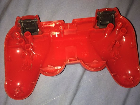 After you unscrewed all five screws in the back, next you're going to have to gently pull both of the controller sides apart and it will come straight off.