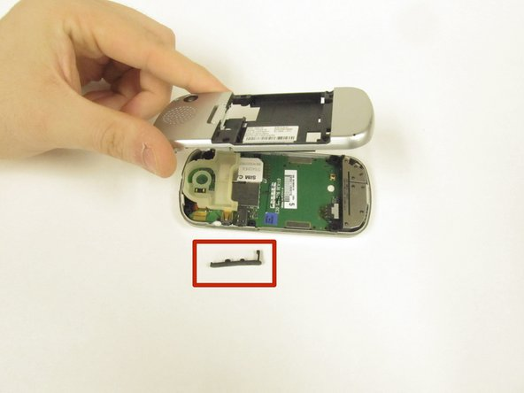 When you remove the rear housing, the rubber cover for the headphone jack/charge port may fall out. If not, remove it.