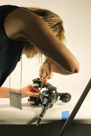 Educator repairs a device