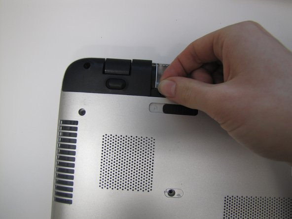 Remove the black corner covers on either side of the battery to reveal four additional 6.5mm Phillips #00 screws.