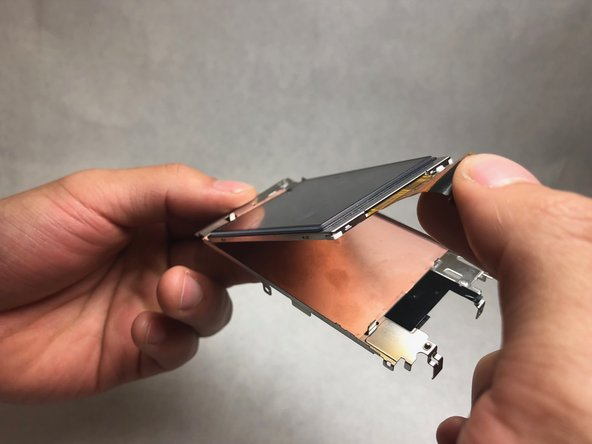 Lift the LCD screen from it's metal housing.
