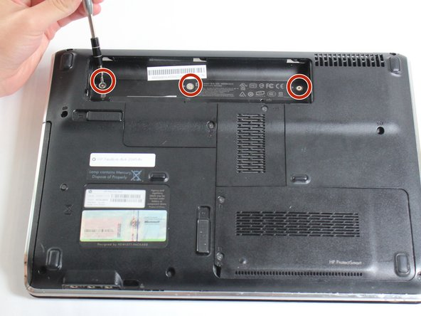 Turn the laptop over so the bottom is facing up and the hinges are pointed away from you.