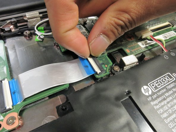 Use a fingernail or a spudger to flip up the white tab on the zero insertion force connector on the bottom left of the motherboard.
