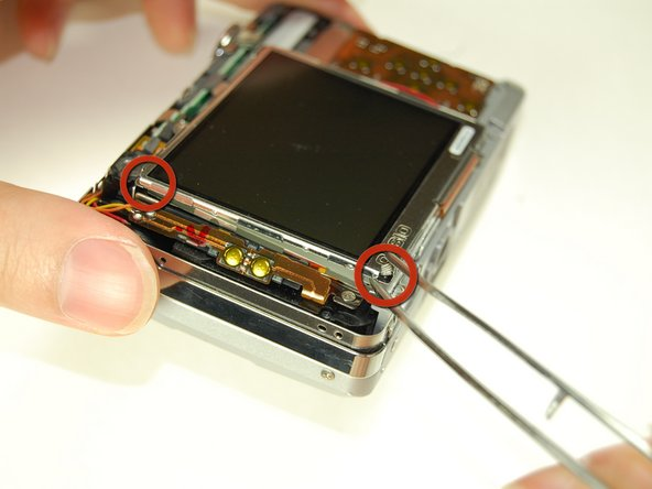 Note: The bottom of the LCD screen is attached to the frame by a few pieces of black tape.