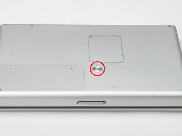 Use a coin to turn the battery locking screw 90 degrees to the right.
