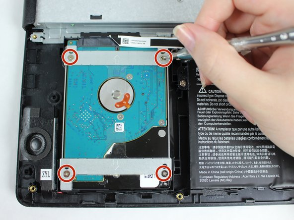 Remove the four 4.5 mm screws that hold the hard drive in place.
