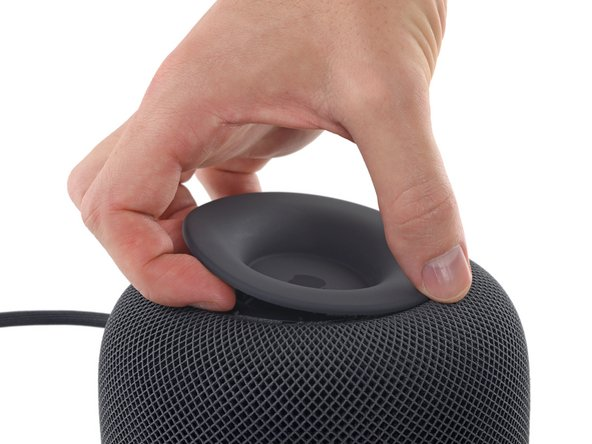 Using your fingernails or a guitar pick, separate the outer portion of the foot from the mesh and remove from the HomePod