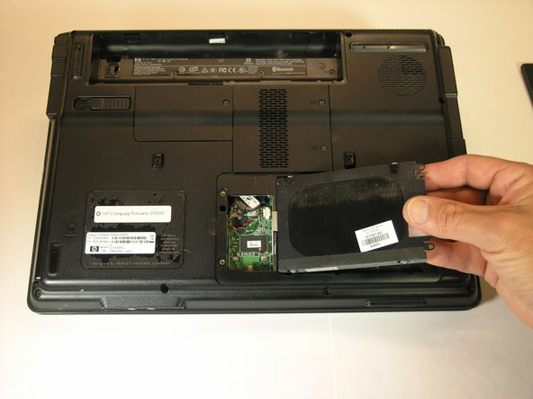 Lift the hard drive up from the laptop. Be careful not to left it all the way.