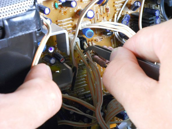 Image 2/3: Use tweezers to remove the 6 ribbon cables.