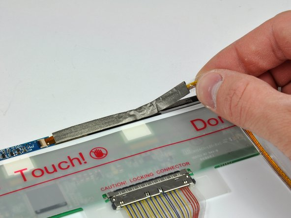 Carefully peel the camera cable off the foam tape along the top edge of the LCD.