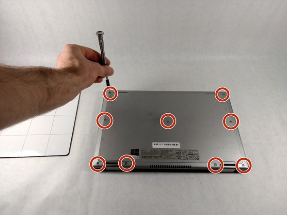 Using the Phillips #1 screwdriver, remove all nine 7mm screws.