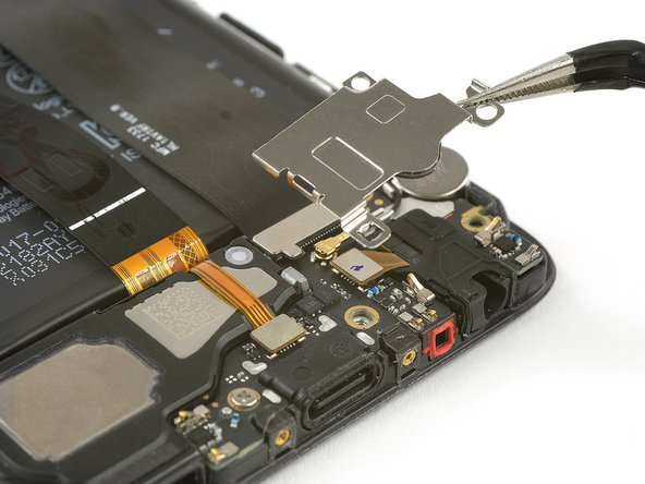 Use tweezers to remove the metal plate.