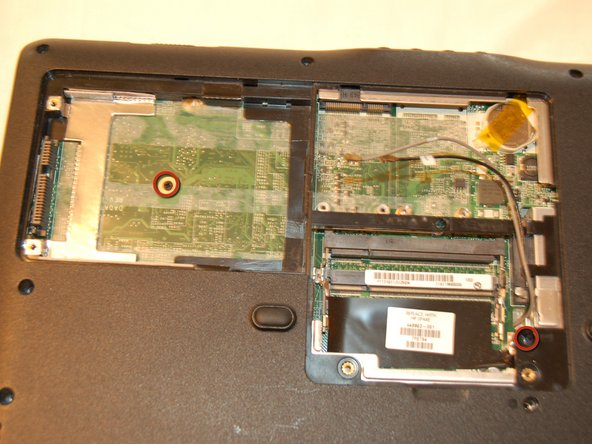 Remove the one keyboard-branded screw in the memory compartment, and the one screw from the hard drive compartment.