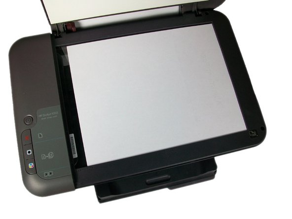 Open up the scanner lid and place the alignment page face-down in the right-front corner of the glass.