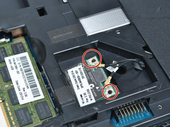Undo the two screws on the corners of the wireless card.