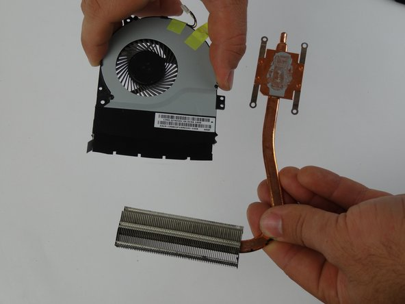 Remove radiator by tilting it down and pulling it out from the fan.