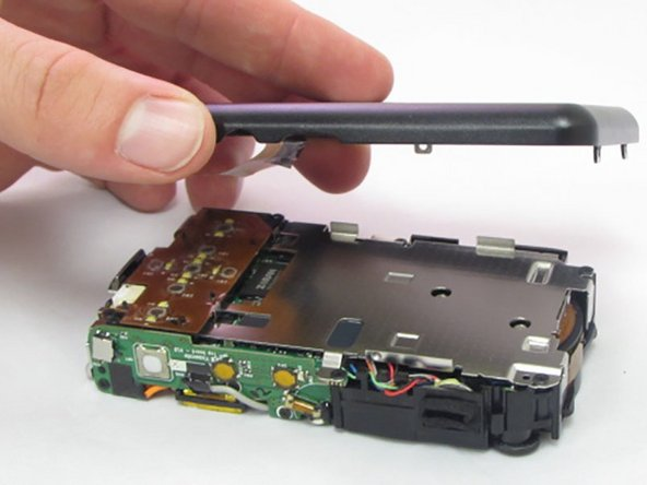 The LCD screen is held onto the back casing by a small amount of adhesive. This may come loose during this process. Do not worry if they become separated.