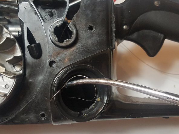 Use a pair of long needle nose pliers or hemostats to grab the other end through the gas tank