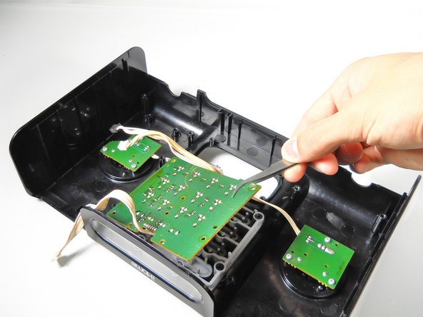 Use tweezers to carefully remove the largest circuit board.