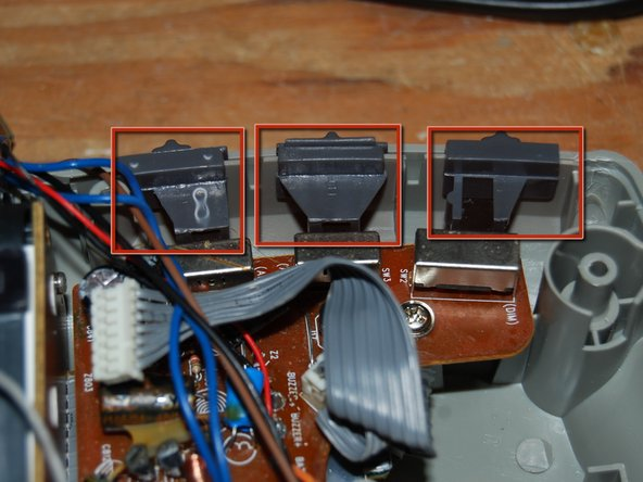 Remove three selector switches. They pull off easily. Note their locations. Or play Tetris later figuring out where they go.
