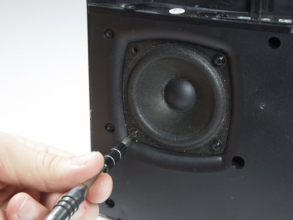 Remove the eight 10mm screws that surround the speakers. There will be four around each speaker.