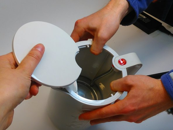 After removing the ring, flip the kettle and remove the lid by pulling the kettle  a little bit  to transform the circle,.  You might need another pair of hands for this step.