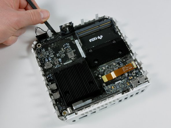 Image 1/2: Grasp the logic board with your hand and pull it away from the I/O ports.