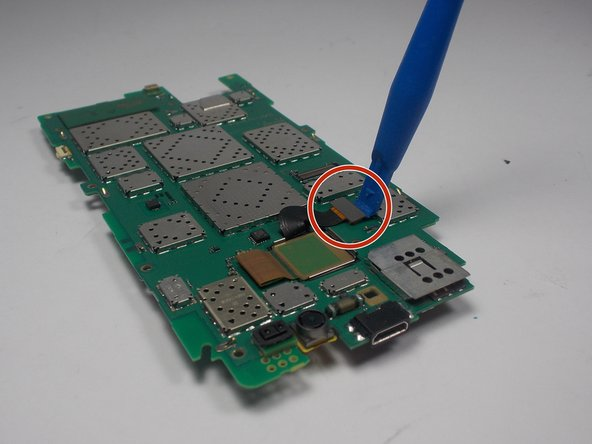 Now that the battery is separated from the motherboard, it is time to remove it. First you will need to lift the connector for the battery's ribbon cable.