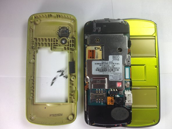 Image 3/3: Gently lift and remove the rear case from the cell phone.