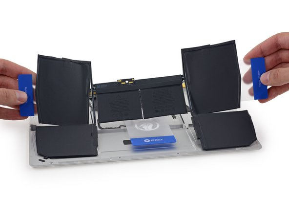 Image 2/2: Apple says that they use photos from high-speed cameras to help align these batteries in their cases, [http://www.apple.com/macbook/design/|accounting for variations at the microscopic level|new_window=true].