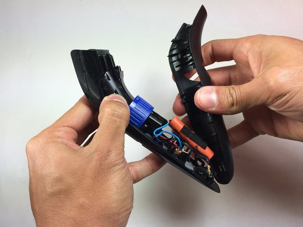 Image 2/3: Pull the wires attached to the battery off of the power connectors before completely removing the back panel.