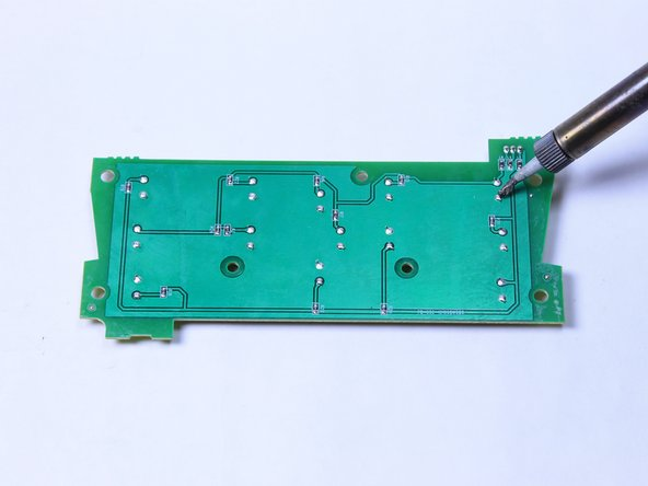 Image 3/3: The buttons will be labeled on the top of the circuit board, and you will be working with the corresponding connections on the back.