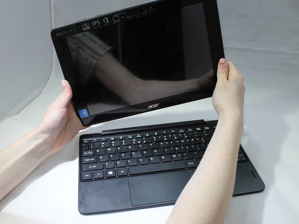 To disconnect the tablet from the keyboard attachment, open the laptop and lift the tablet component up from the keyboard dock.