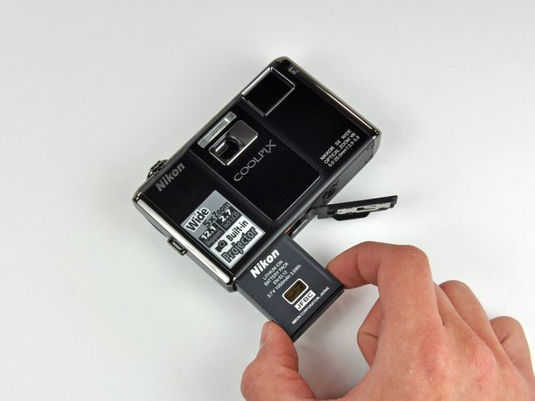 Removing the rechargable lithium-ion battery.