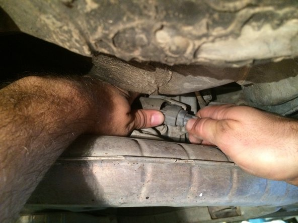 Unplug the rear oxygen sensor connector and carefully route the wires through the Exhaust Front Cover so they are no longer passing through it.