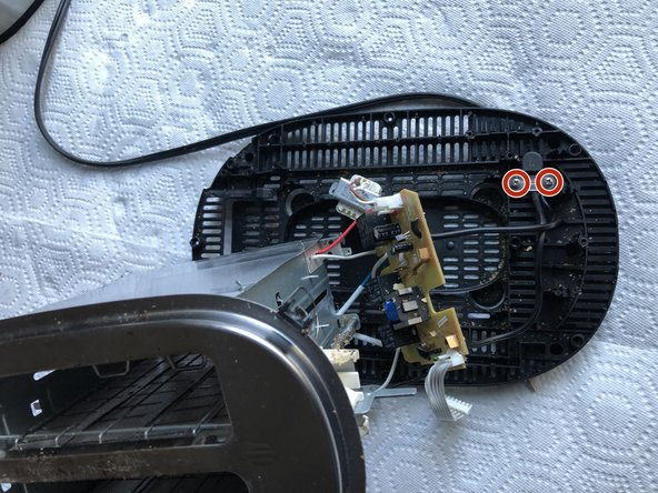 Pull apart toaster components.  If power cable needs to be removed or adjusted, unscrew the screws circled.