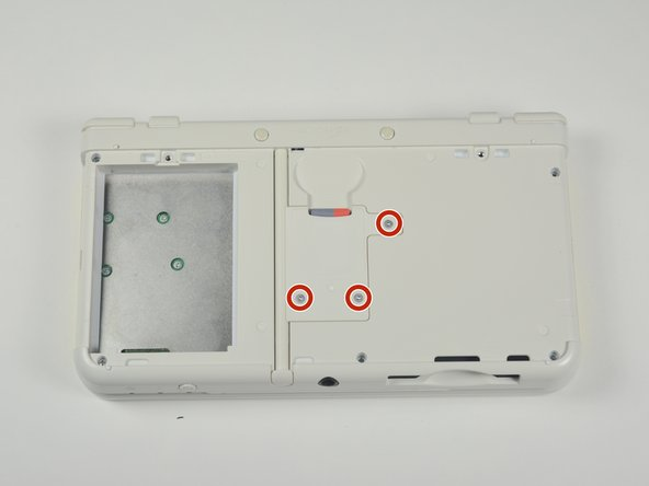 Image 1/1: The bottom of the SD card reader should slightly pop out after removing the screws.
