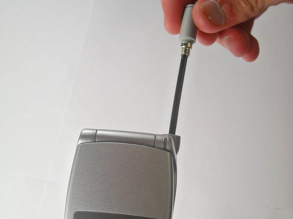 Unscrew and remove antenna from socket