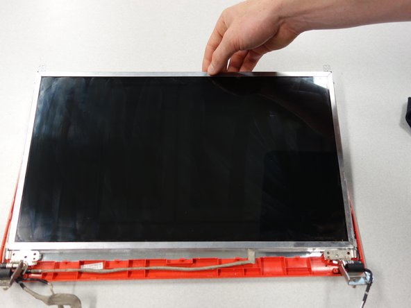 Lift the screen away from the back panel.