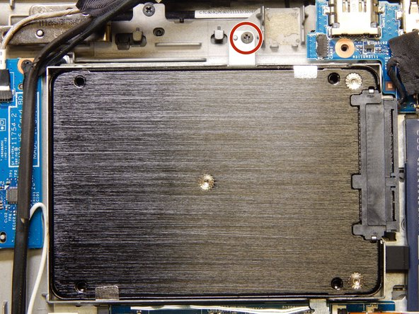 Using a Phillips #0 screwdriver, remove the single 3 mm screw from the top of the hard drive sled.