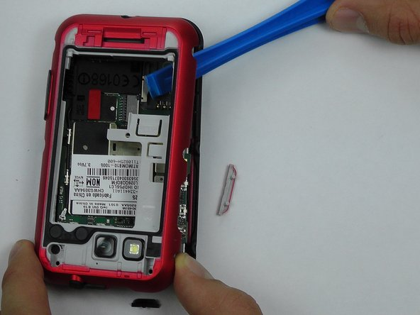Use a plastic opening tool to gently pry the midframe from the rest of the phone.