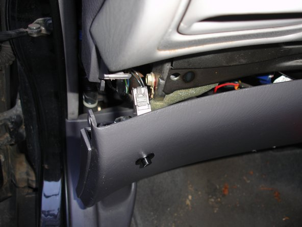 Now the driver's side lower panel can be removed. Begin on the left side and gently pull it off, so that all of the retaining clips are released.