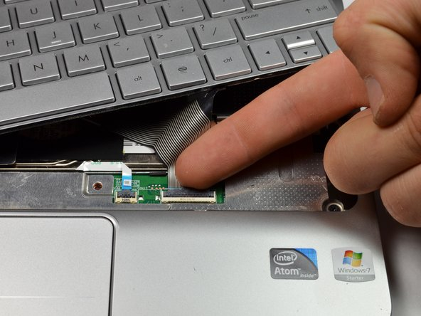 Use your fingernail to flip up the black retaining flap attached to the keyboard ZIF connector.