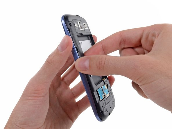 Grasp the left side of the plastic midframe with your thumb and forefinger and lift it away from the phone.